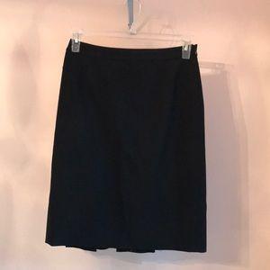 Size 4 Loft. Black suit skirt with back flounce